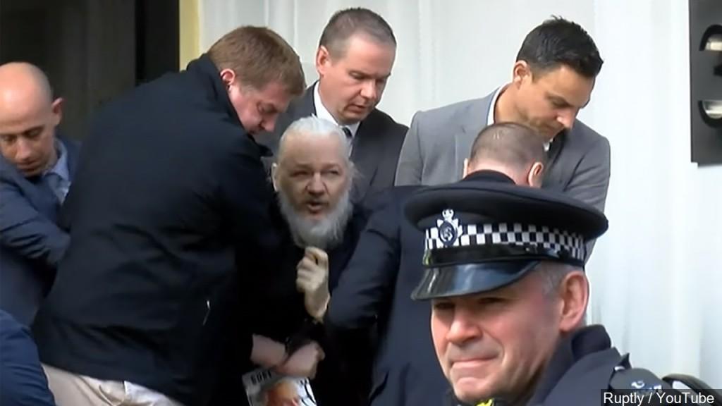 Wikileaks founder being taken into custody.