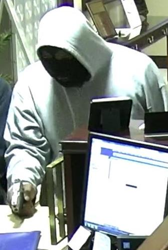 Security camera image of man accused of robbing Central Bank branch on West New Circle Road in Lexington at gunpoint on 5-13-19