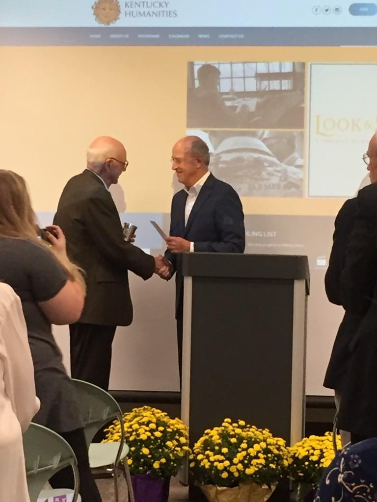 Bill Goodman presents award winner Wendell Berry