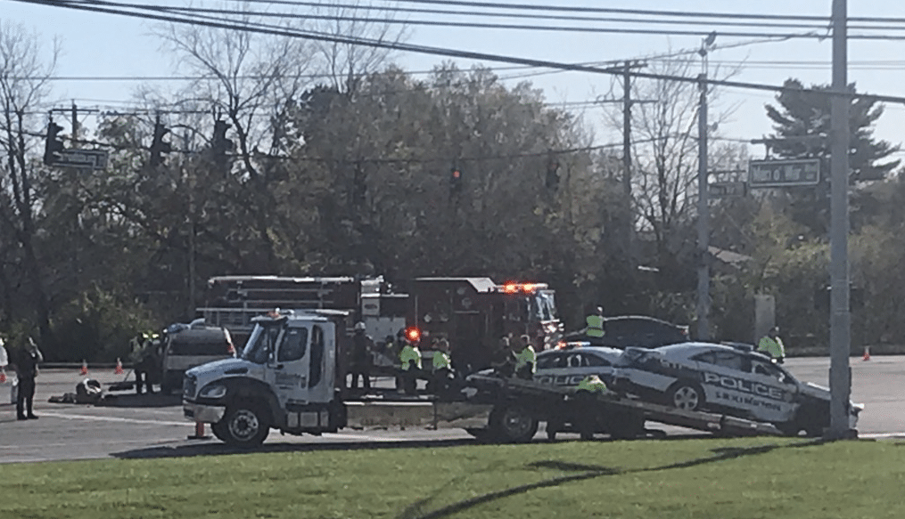 Lexington Police car on its way to a call with lights and siren on involved in collision at Harrodsburg Road at Man O' War Boulevard on 11-16-20.  The officer and several other people suffered minor injuries.  The police car and one other vehicle involved.