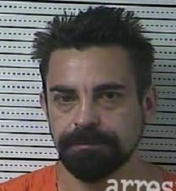 Danville man accused of breaking into his neighbor's apartment with a knife