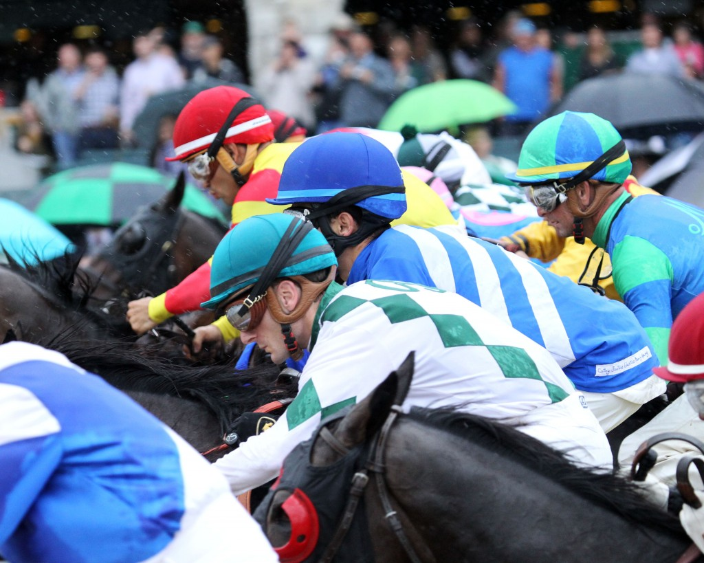 Horses break from the starting gate at Keeneland during the spring meet