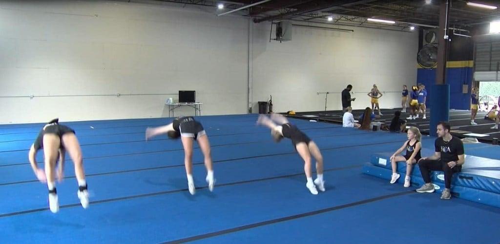Athletes doing back flips at Kentucky Cheer Academy in Lexington