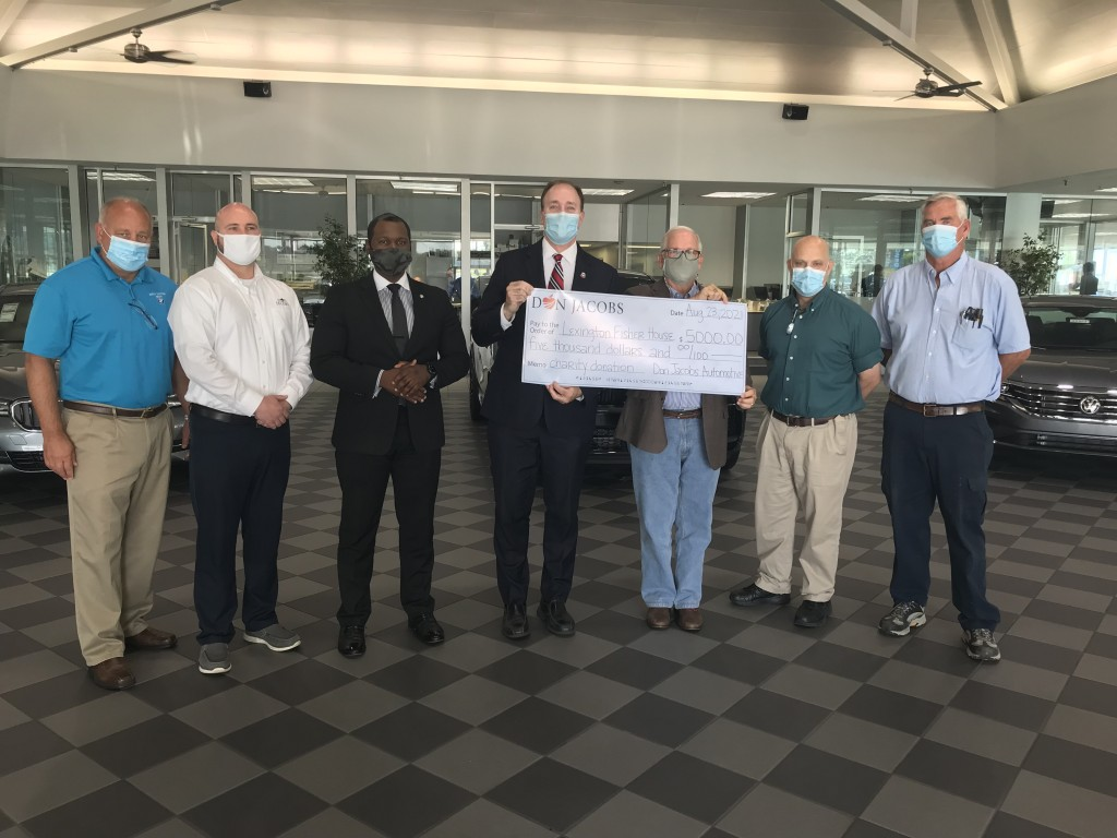 Don Jacobs Automotive Group in Lexington presents check for $5