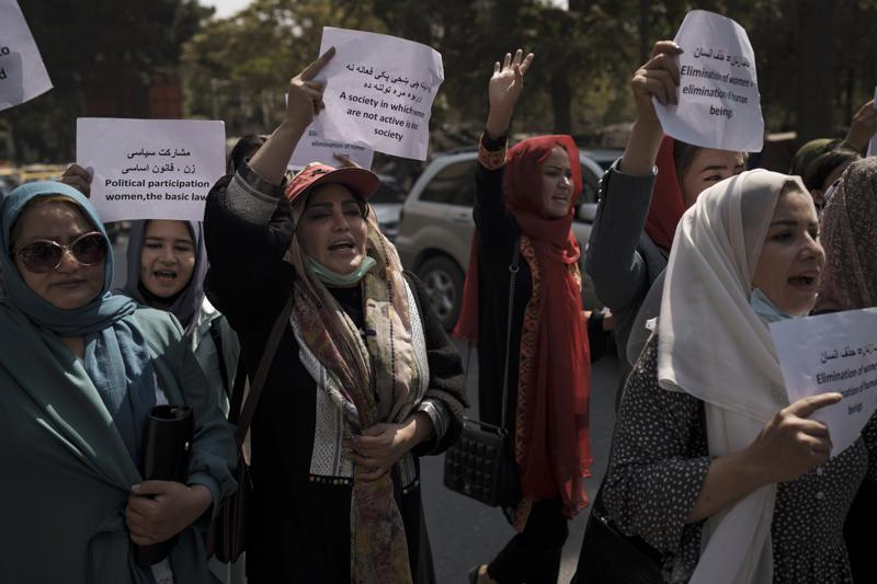 Women march to demand their rights under the Taliban rule during a demonstration near the former Women's Affairs Ministry building in Kabul