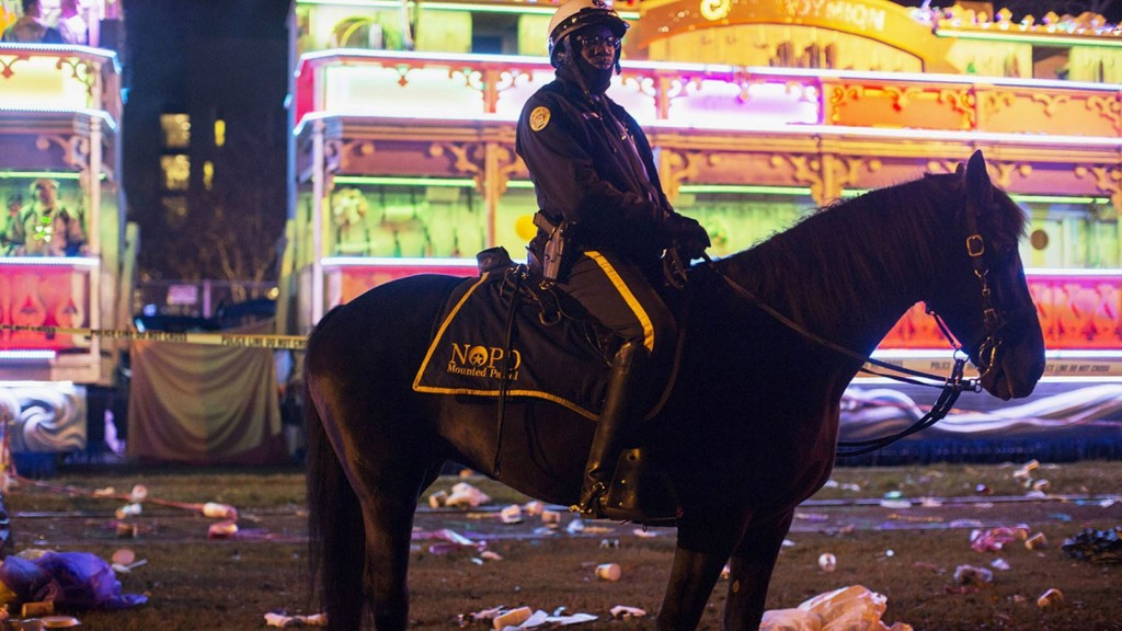 A police officer works the scene where a man was reportedly hit and killed by a float of the Krewe of Endymion parade in the runup to Mardi Gras in New Orleans