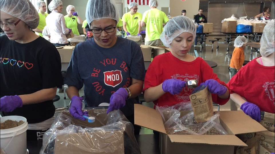 Volunteers package nearly 10,000 meals to fight against child hunger