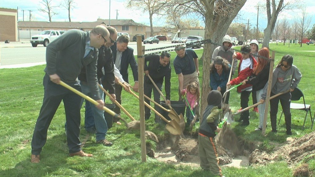 Families help plant several trees in Pasco in observance of Arbor Day