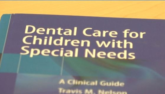 Local pediatric dentist co-writes a textbook
