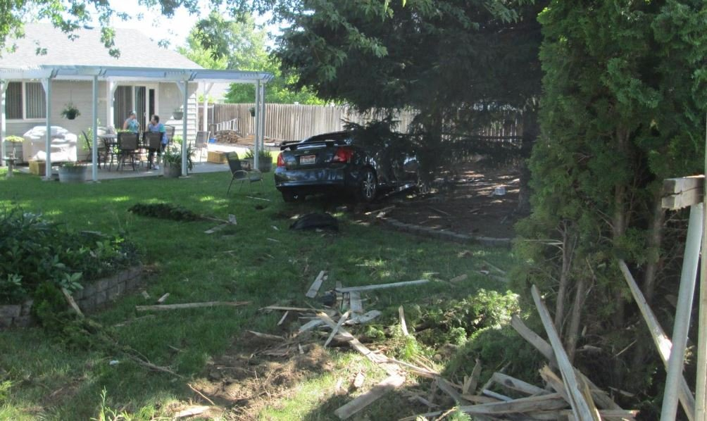Driver arrested for DUI after hitting car, crashing through fence