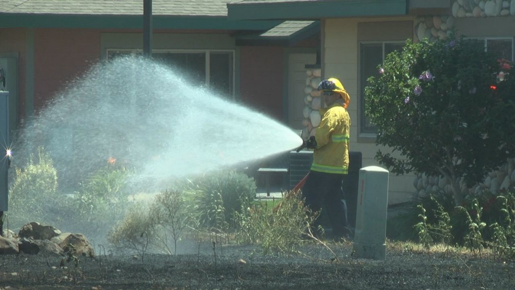 Kennewick crews investigate fire that may have ignited from lawn mowing