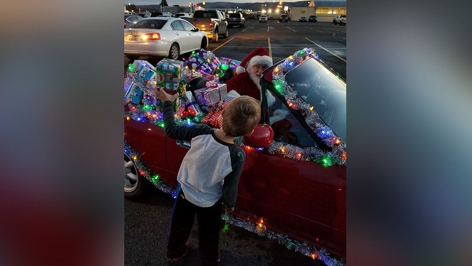Santa lives in Ellensburg and his sleigh is a red Miata