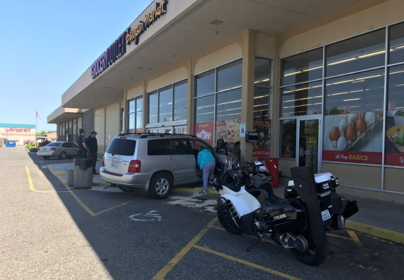 Woman accidentally crashes into Grocery Outlet