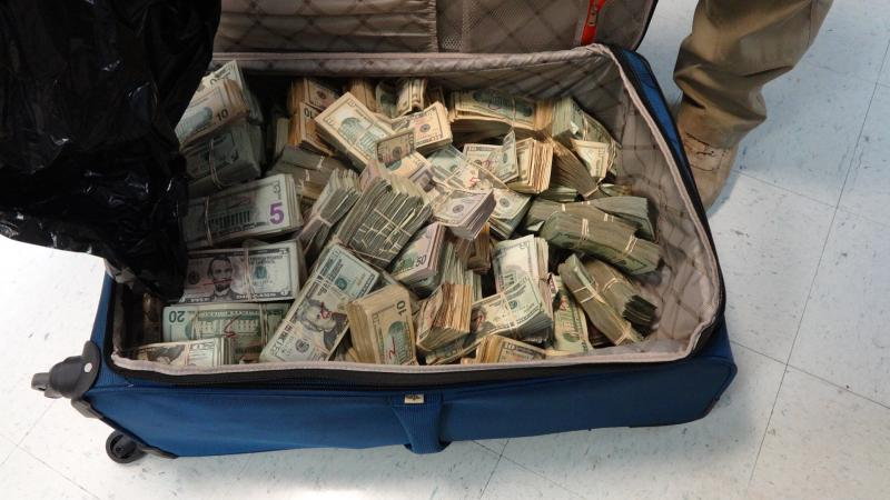 Woman arrested with over $530K cash in suitcase during traffic stop