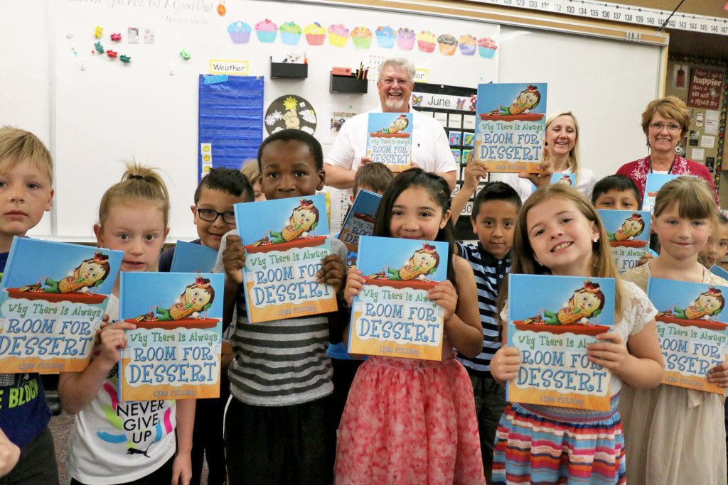 Local author donates thousands of children's book to schools