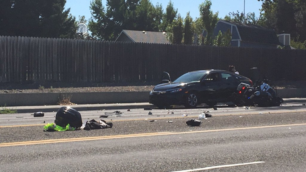 Driver crashes into Kennewick police motorcycle
