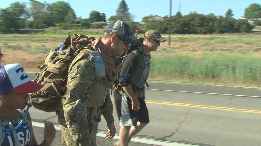 Local veteran honors other vets, carries 100 pound pack 20 miles