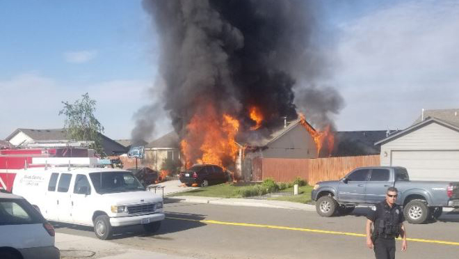 Three people injured in Pasco house fire, official says