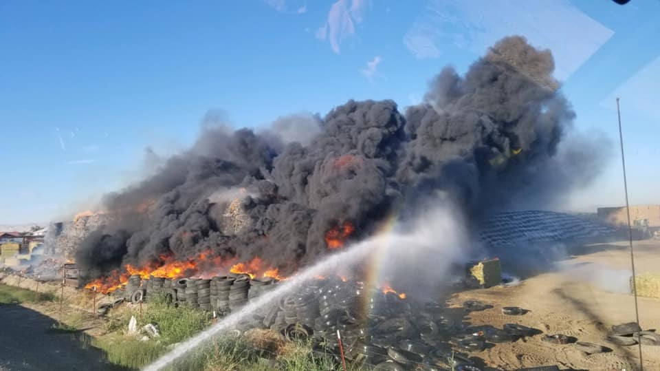 Yakima firefighters hose over 200 tons of hay, 100 tires on fire