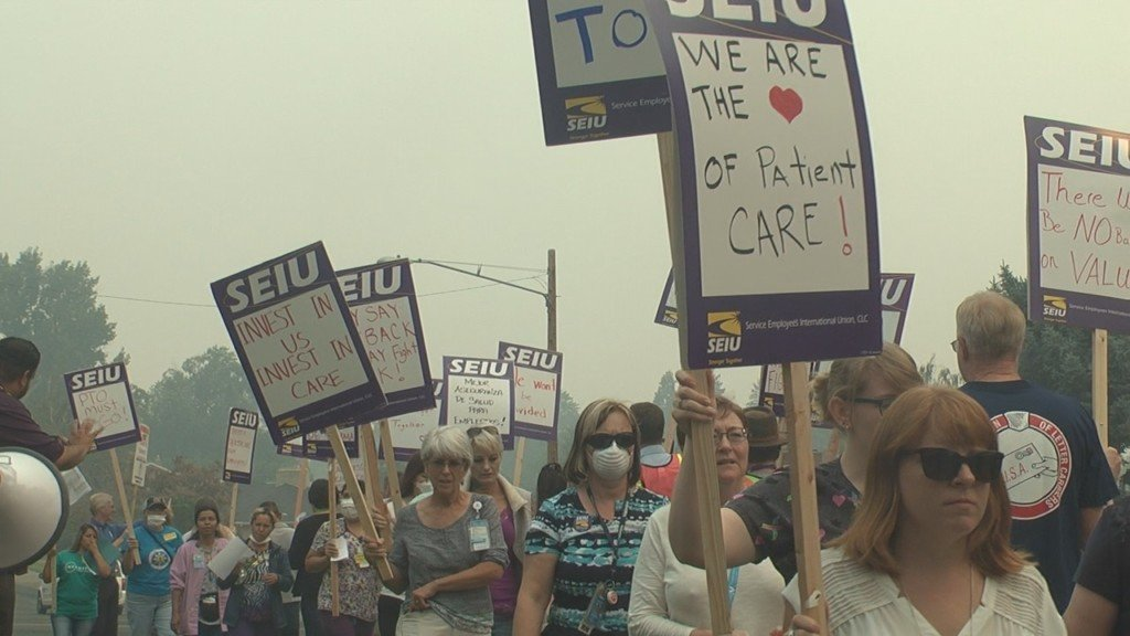 Healthcare workers picket at Virginia Mason Memorial for better healthcare plan