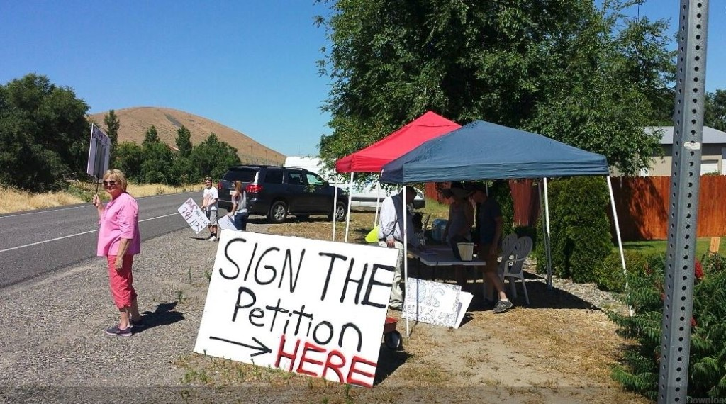 West Richland residents hold petition signing against new cannabis shop