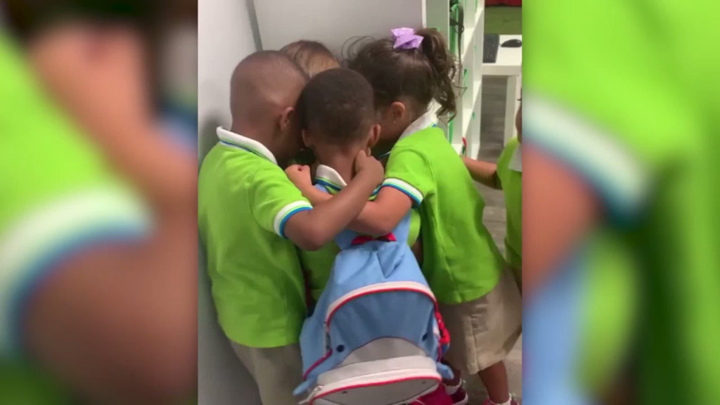 Preschoolers hug classmate who rode out Hurricane Dorian