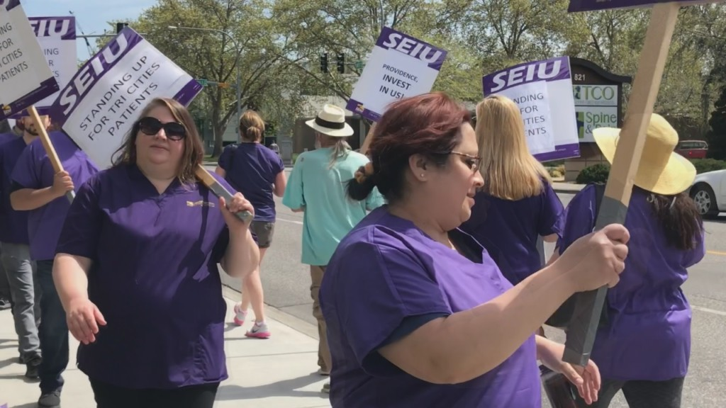 Caregivers picket outside Kadlec, demand better pay