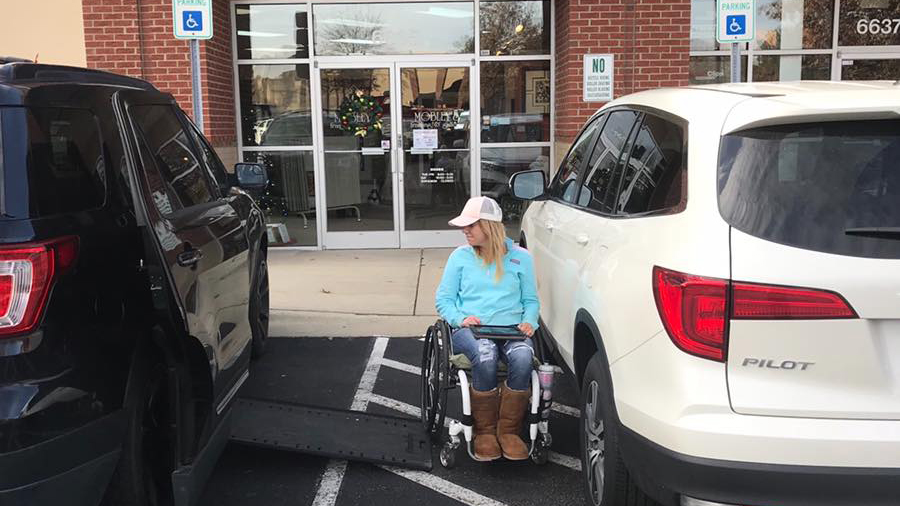 Quadriplegic woman reminds drivers to park between the lines