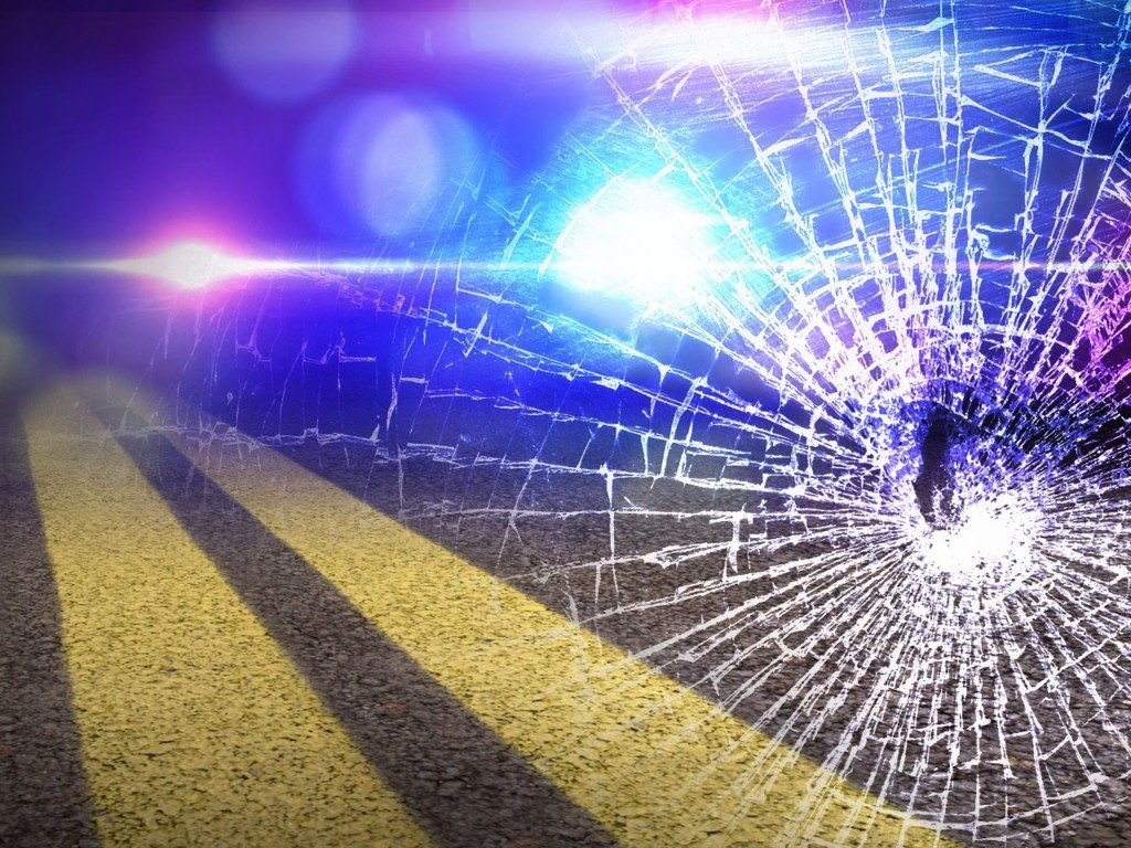 Woman struck with bullet while driving