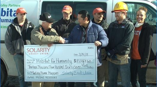 Solarity Credit Union employees donate over $13K to Habitat for Humanity