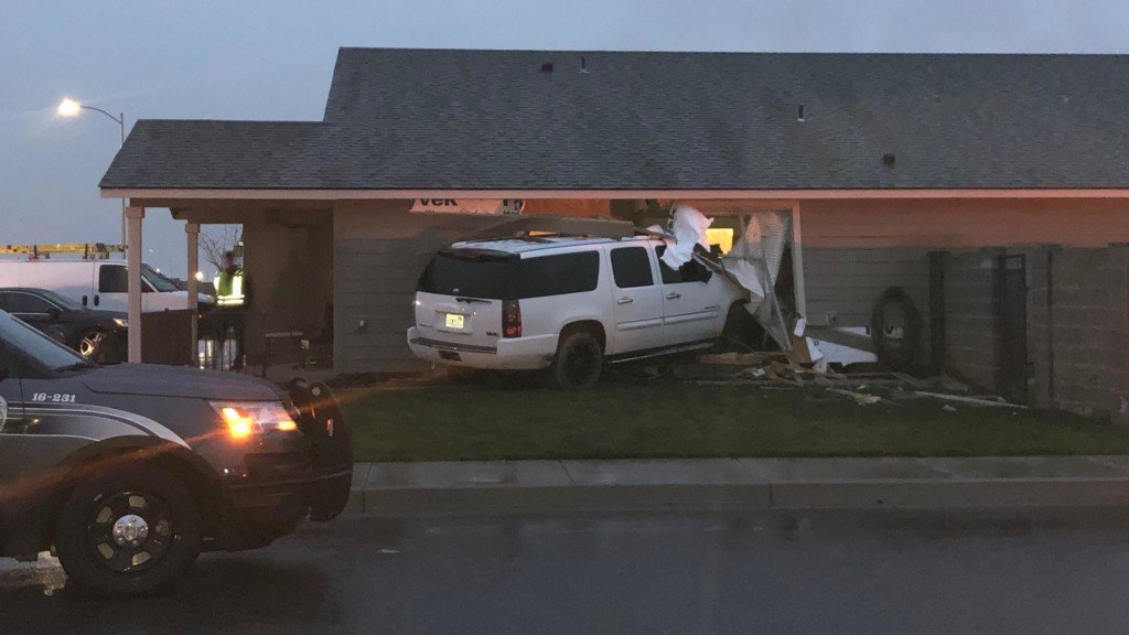 Child injured after suspected DUI driver crashes into house