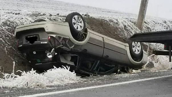 Firefighters respond to icy rollover crash