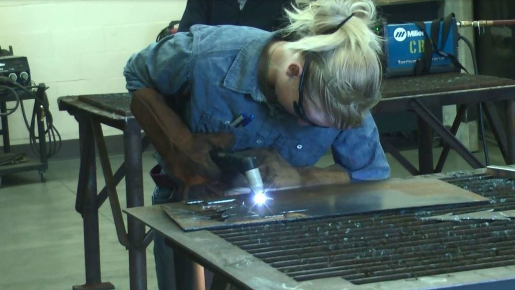 High school students create works of art out of metal scraps
