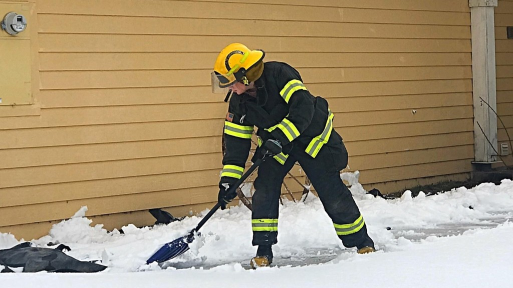 Grant Co. firefighter shovels driveway