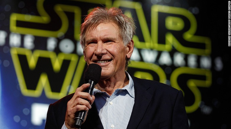 Harrison Ford on stage with Star Wars logo in the background