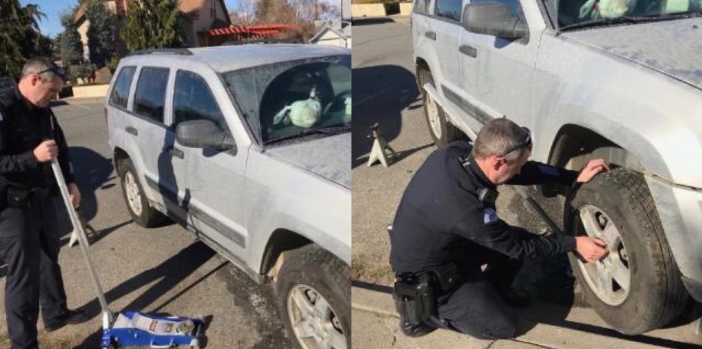 Pasco officer changing tires