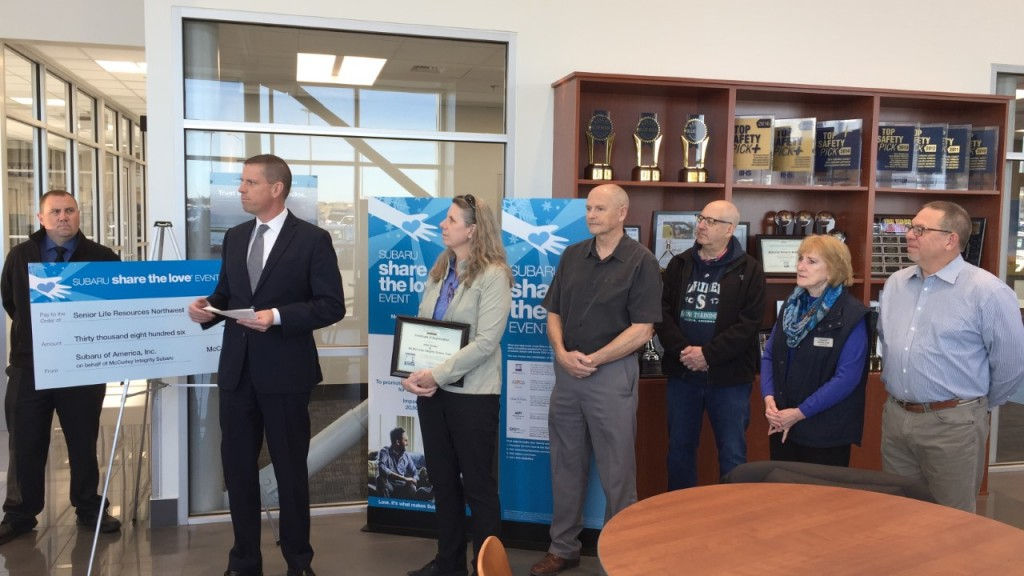 McCurley donates check to Meals on Wheels