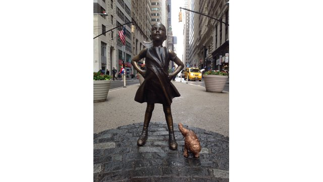 'Fearless Girl' joined briefly by 'Peeing Pug' statue