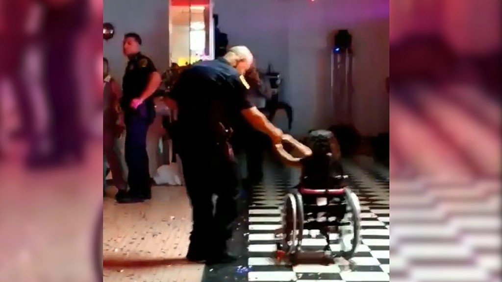 Police officer asks girl in wheelchair to dance. Internet swoons