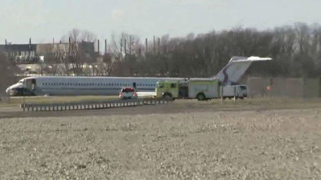 Plane carrying Michigan team slides off runway