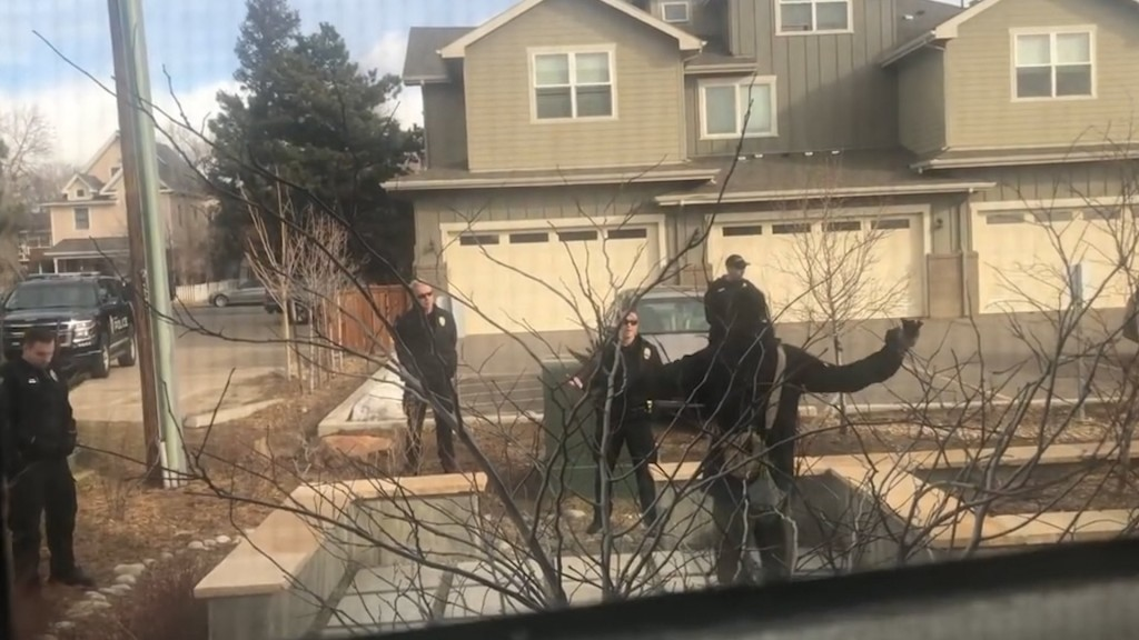 Police confront black man picking up trash on his own property