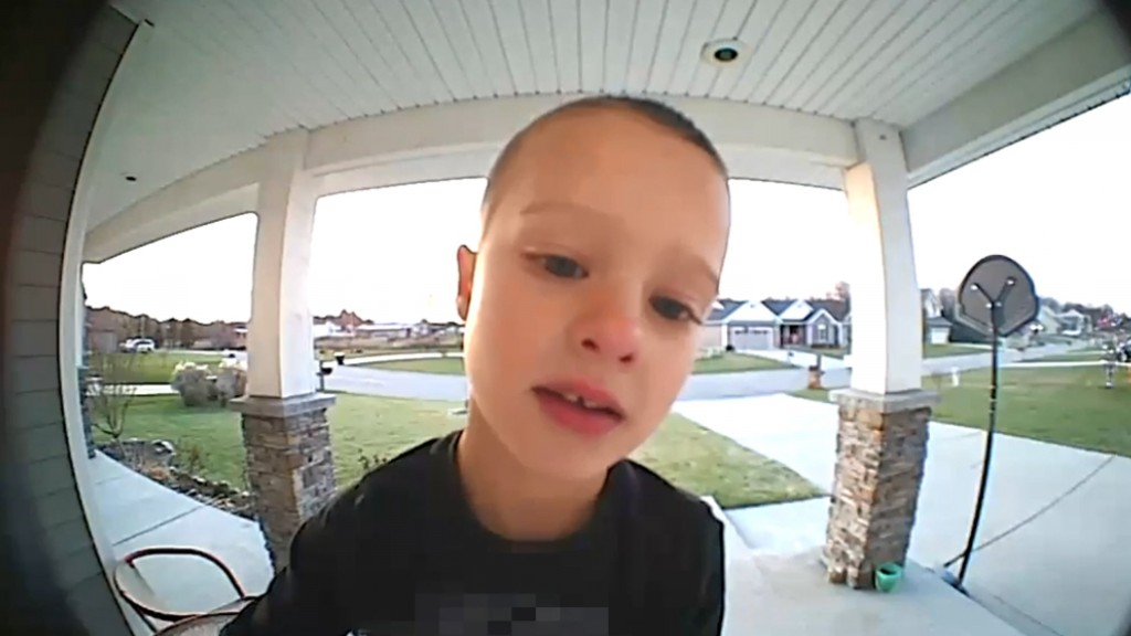 Boy uses video doorbell for important question