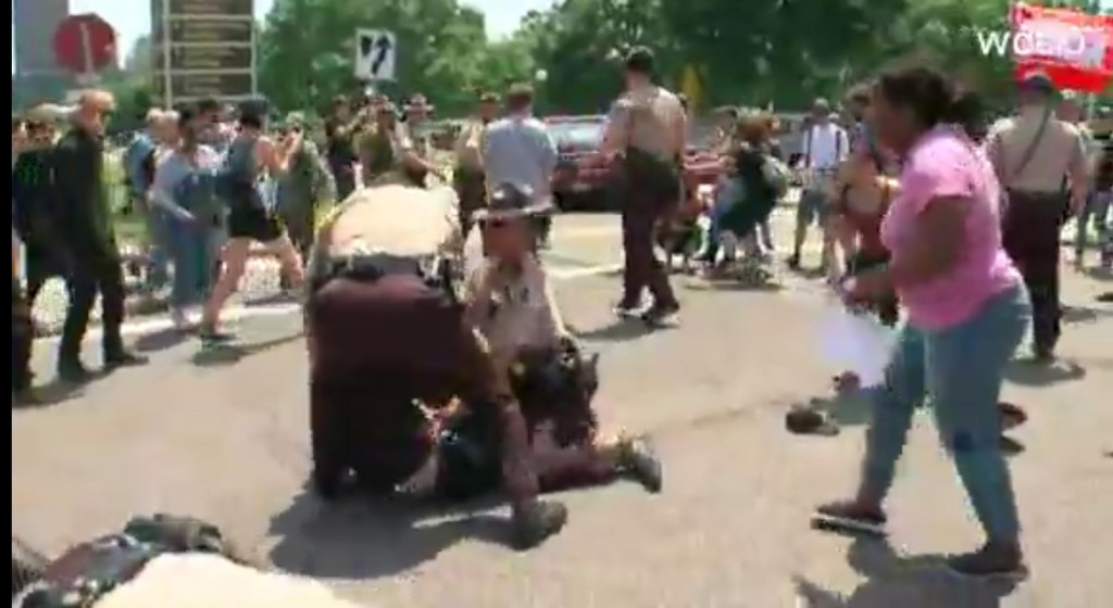 Group against Islamic law clashes with counterprotesters