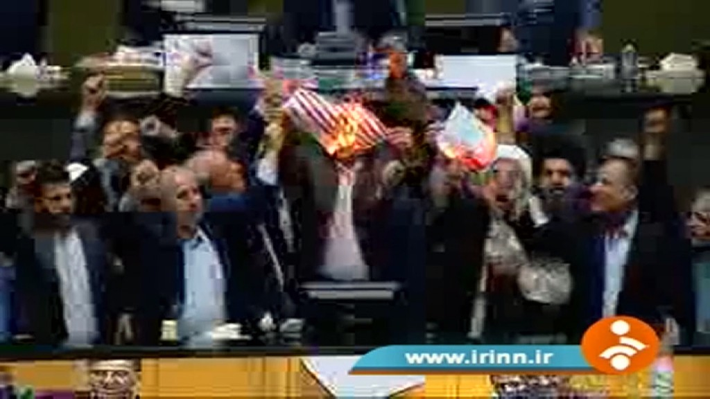 In Iran, hardliners burn the deal, American flag