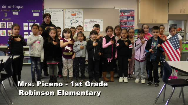 Raise The Flag: Mrs. Piceno's 1st Grade Class At Robinson Elementary