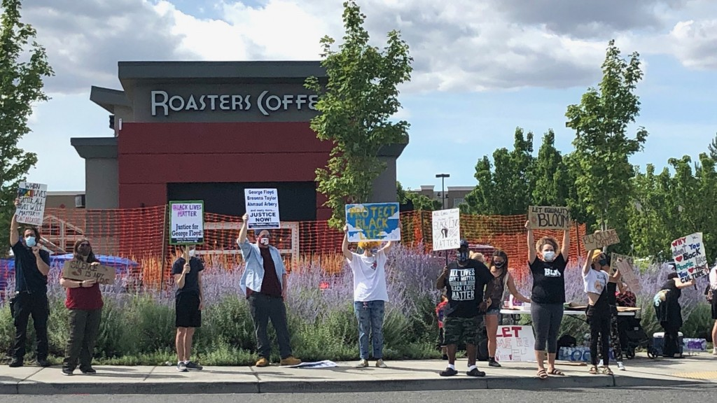 Protesters gather at Roasters Coffee