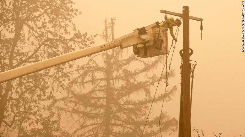 Workers Continue To Repair The Power System After Flames From The Beachie Creek Fire Burned Through Fishermen's Bend Recreation Site In Mill City Oregon
