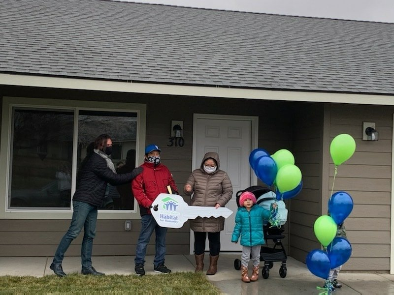 Kyaw Htoo and his family receive the keys to their new home in Pasco from Habitat for Humanity