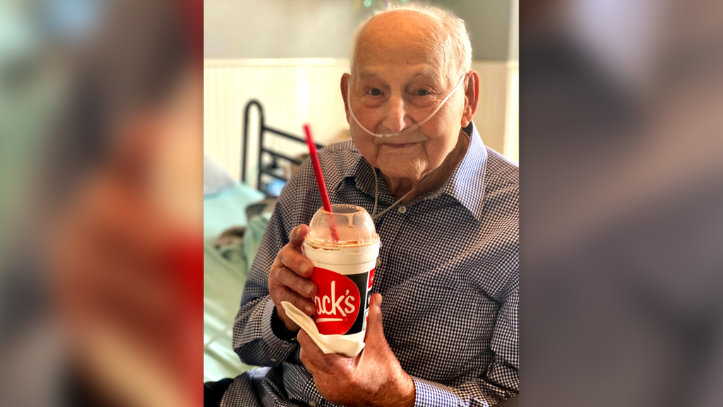 In this photo provided by Holly Wooten McDonald, World War II veteran and COVID-19 survivor Major Wooten holds a celebratory milkshake on his 104th birthday on Thursday, Dec. 3, 2020, in Madison, Alabama. Wooten was released from the hospital this week after contracting the illness caused by the new coronavirus before Thanksgiving.