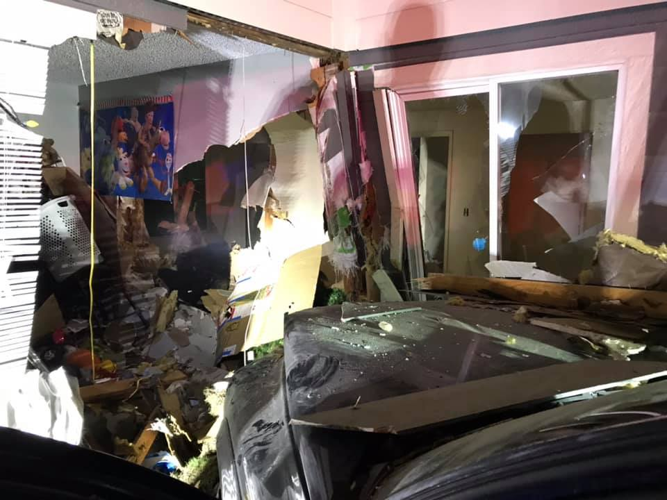 Woman crashes car into apartments in Kennewick, WA.